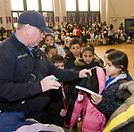 WATERBURY, CT-122117JS05---Waterbury firefighter Lt. Ned Partridge, ,was one of the many firefighters helping distribute coats to students during a winter coat giveaway Thursday at Bucks Hill School in Waterbury. 300 coats were given away to children from the Waterbury School District with help from the Waterbury Fire Department, and donor support from Cigna, MacDermid, Inc., and Brass Axe Capital and partnership with Operation Warm. <br /> Jim Shannon Republican-American