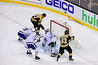 April 25, 2018: Boston Bruins center Patrice Bergeron (37) scores a goal against Toronto Maple Leafs goaltender Frederik Andersen (31) during game seven of the first round of the National Hockey League's Eastern Conference Stanley Cup playoffs between the Toronto Maple Leafs and the Boston Bruins held at TD Garden, in Boston, Mass. Boston defeats Toronto 7-4 and wins the best of seven series 4 games to 3 to advance to round two.