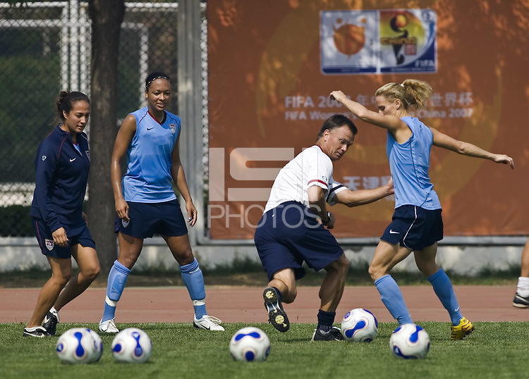 USA head coach Greg Ryan tries to take the ball away from forward Kristine Lilly while at practice at the Tianjin Sports School in Tianjin, China on September 21, 2007.