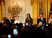 United States President Barack Obama and First Lady Michelle Obama attend the second Hanukkah reception of the day with the grand-daughter and son of Simon Peres, Mika Almog (2L) and Chemi Peres (L) in the East Room of the White House, December 14, 2016, Washington, DC. <br /> Credit: Aude Guerrucci / Pool via CNP