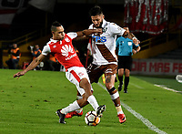 BOGOTA - COLOMBIA - 20 - 02 - 2018: Anderson Plata (Izq.) jugador de Independiente Santa Fe disputa el balón con Reiner Castro (Der.) jugador de Santiago Wanderers, durante partido de vuelta entre Independiente Santa Fe (COL) y Santiago Wanderers (CHL), de la fase 3 llave 1, por la Copa Conmebol Libertadores 2018, jugado en el estadio Nemesio Camcho El Campin de la ciudad de Bogota. / Anderson Plata (L) player of Independiente Santa Fe vies for the ball with Reiner Castro (R) player of Santiago Wanderers, during a match for the second leg between Independiente Santa Fe (COL) and Santiago Wanderers (CHL), of the 3rd phase key 1, for the Copa Conmebol Libertadores 2018 at the Nemesio Camacho El Campin Stadium in Bogota city. Photo: VizzorImage  / Luis Ramirez / Staff.