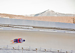 8 January 2016: Donna Creighton, competing for the United Kingdom, slides through Curve 14, with Whiteface Mountain as a backdrop, on her first run of the BMW IBSF World Cup Skeleton race at the Olympic Sports Track in Lake Placid, New York, USA. Mandatory Credit: Ed Wolfstein Photo *** RAW (NEF) Image File Available ***