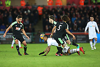 Jordan Ayew of Swansea City is tackled by Harry Arter of Bournemouth during the Premier League match between Swansea City and Bournemouth at the Liberty Stadium, Swansea, Wales, UK. Saturday 25 November 2017