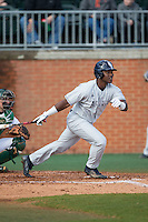 Christian Dicks (11) of the Florida Atlantic Owls follows through on his swing against the Charlotte 49ers at Hayes Stadium on March 14, 2015 in Charlotte, North Carolina.  The Owls defeated the 49ers 8-3 in game one of a double header.  (Brian Westerholt/Four Seam Images)