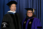 Commencement speaker and honorary degree recipient Stuart Dybek, poet and fiction writer, left, and Marisa Alicea, dean of the School for New Learning. DePaul University School for New Learning held its commencement ceremony, Saturday, June 10, 2017, at the Rosemont Theatre in Rosemont, IL. The Rev. Dennis H. Holtschneider, C.M., president of DePaul, conferred the degrees. (DePaul University/Jeff Carrion)