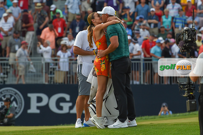 Jena Sims rushes to congratulate her fiance, Brooks Koepka (USA) on the green on 18 for winning the 100th PGA Championship at Bellerive Country Club, St. Louis, Missouri. 8/12/2018.<br /> Picture: Golffile | Ken Murray<br /> <br /> All photo usage must carry mandatory copyright credit (© Golffile | Ken Murray)