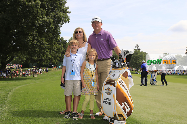 Shaun Micheel (USA) with his family beside the commemorative plaque to honour his winning shot at the 2003 PGA Championship here on the 18th hole during Wednesday's Practice Day of the 95th US PGA Championship 2013 held at Oak Hills Country Club, Rochester, New York.<br /> 7th August 2013.<br /> Picture: Eoin Clarke www.golffile.ie