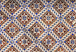 Historic old patterned ceramic tiles on a wall in Portugal