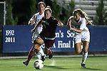 14 August 2014: South Carolina's Savannah McCaskill (7) is defended by Duke's Schuyler DeBree (right) and Mary Elizabeth Bender (left). The Duke University Blue Devils hosted the University of South Carolina Gamecocks at Koskinen Stadium in Durham, NC in a 2014 NCAA Division I Women's Soccer preseason match. Duke won the exhibition 2-0.