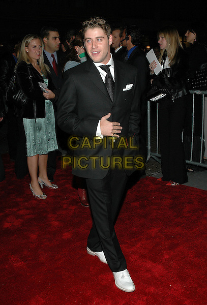 "JON ABRAHAMS.Premiere of her new film ""Prime"" at the famed Ziegfeld Theater in Manhattan, New York, New York..October 20th, 2005 .Photo Credit: Patti Ouderkirk/AdMedia/Capital Pictures.Ref: PO/ADM.full length black suit.www.capitalpictures.com.sales@capitalpictures.com.© Capital Pictures."
