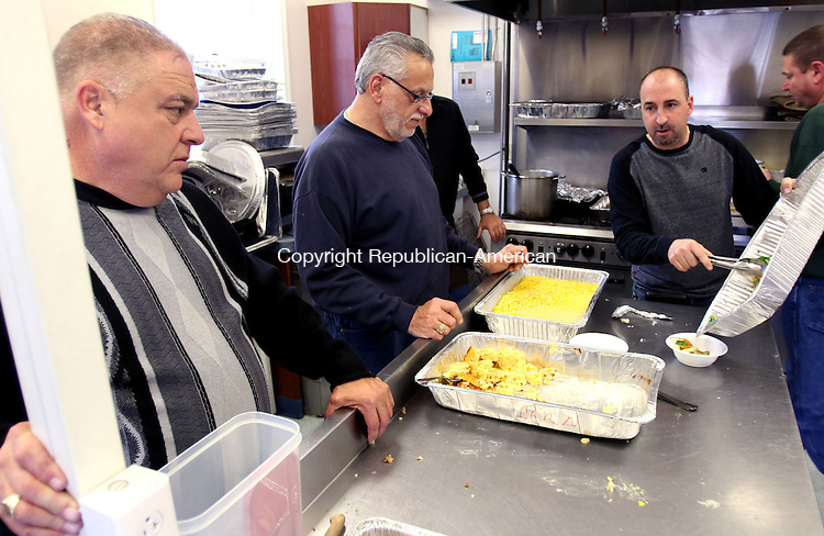 TORRINGTON CT. 26 November 2015-112615SV11-From left, Walter Sherman, Bob Teixeira and Carmen Gianni all of Wolcott serve turkey dinner at the Senior Center in Wolcott Thursday. The dinner was offered to Wolcott residents and senior center members who otherwise might be alone on Thanksgiving. Deliveries were made to residents who cannot attend. A team of volunteers has cooked over 30 turkeys, along with gravy, potatoes, sweet potatoes, corn casserole, green bean casserole, turkey soup, appetizers and many desserts. <br /> Steven Valenti Republican-American