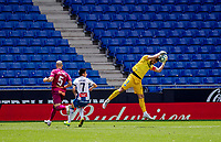 13th June 2020, Barcelona, Spain; La Liga football, RCD Espanyol versus Alaves;  Alaves goalkeeper Fernando Pacheco saves the ball in the penalty area as Espanyols Wu Lei  closes in