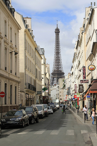 Street and Eiffel Tower, Paris, France.