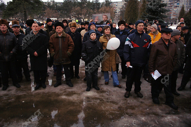 People listened to united opposition candidate for the presidential elections in Belarus Alexander Milinkevich as he spoke at a rally in the town of Borisov outside a cinema.