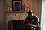 Eric Caine at home in Riverside, Illinois on December 13, 2015.  Caine spent 25 years wrongly incarcerated for a crime he did not commit, the murder of an elderly couple in 1986, which he was tortured into confessing by detectives linked to routine abuses including torture who worked under former Chicago Police Commander Jon Burge; Caine was freed on March 16, 2011, the same day Burge began a sentence on perjury charges related to lying about torture under oath.