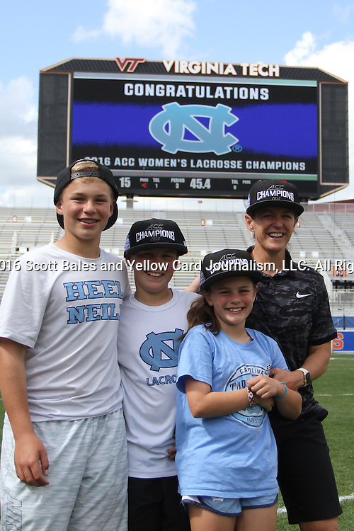 01 May 2016: UNC head coach Jenny Levy with her children. The University of North Carolina Tar Heels played the Syracuse University Orange at Lane Stadium in Blacksburg, Virginia in the 2016 Atlantic Coast Conference Women's Lacrosse Tournament championship match. North Carolina won 15-14 in overtime.