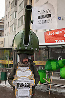 Moscow, Russia, 04/02/2012..A protester dressed as a tank as tens of thousands of demonstrators marched in central Moscow and protested against election fraud and Prime Minister Vladimir Putin in temperatures of -20 centigrade. Organisers claimed an attendance of 130,000 despite the bitter cold.
