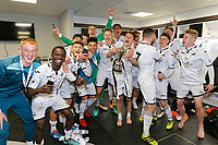 Pictured: Swansea players celebrate with the cup in the changing room. Tuesday 01 May 2018<br /> Re: Swansea U19 v Cardiff U19 FAW Youth Cup Final at the Liberty Stadium, Swansea, Wales, UK