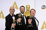 US-LOS ANGELES-OSCARS-BEST ANIMATED FEATURE FILM ---<br /> Directors Don Hall (R), Chris Williams (C) and Roy Conli pose after winning the Best Animated Feature Film award for &quot;Big Hero 6&quot; during the 87th Academy Awards at the Dolby Theater. <br /> Los Angeles, USA - 22/02/2015.