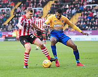 Lincoln City's Harry Anderson vies for possession with Mansfield Town's Krystian Pearce<br /> <br /> Photographer Andrew Vaughan/CameraSport<br /> <br /> The EFL Sky Bet League Two - Lincoln City v Mansfield Town - Saturday 24th November 2018 - Sincil Bank - Lincoln<br /> <br /> World Copyright &copy; 2018 CameraSport. All rights reserved. 43 Linden Ave. Countesthorpe. Leicester. England. LE8 5PG - Tel: +44 (0) 116 277 4147 - admin@camerasport.com - www.camerasport.com