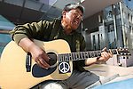 May 2, 2010 - Tokyo, Japan - Rashin Nakamura sings in memory of Ryoko Ishida, a 15-year-old girl who died the morning of July 6, 1990 during an accident that crushed her at the gates of Kobe Takatsuka Senior High School. Pictured in Tokyo on Sunday May 2, 2010, the musician sings in hopes of rekindling the memory of the girl who lost her life due to a strict school policy that humiliates student who are late. He collected 24,000 carnations since the accident occurred and this year will mark the 20th anniversary of the tragedy.