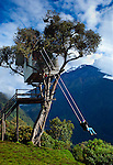 "The ""Swing At The End Of The World"" is an adventure destination in Banos, Ecuador.  The swing carries the swinger out over a deep mountainous canyon and is attached to a treehouse called La Casa del Arbol.  The treehouse was constructed many years ago to monitor the Tungurahua Volcano, which can be seen in the background."