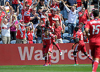 Chicago defender Jalil Anibaba (6) leaps onto the back of midfielder Marco Pappa (16) after Pappa scored the game-tying goal.  The Chicago Fire tied the New York Red Bulls 1-1 at Toyota Park in Bridgeview, IL on June 26, 2011.