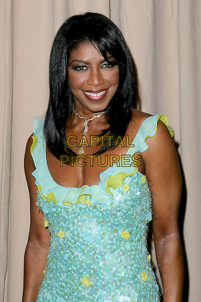 NATALIE COLE<br /> Saks Fifth Avenue's Unforgettable Evening<br /> Benefiting Women's Cancer Research Fund<br /> held at the Regent Beverly Wilshire Hotel, Beverly Hills, USA, 1st March 2005.<br /> half length green turquoise dress<br /> Ref: ADM<br /> www.capitalpictures.com<br /> sales@capitalpictures.com<br /> &copy;JWong/AdMedia/Capital Pictures