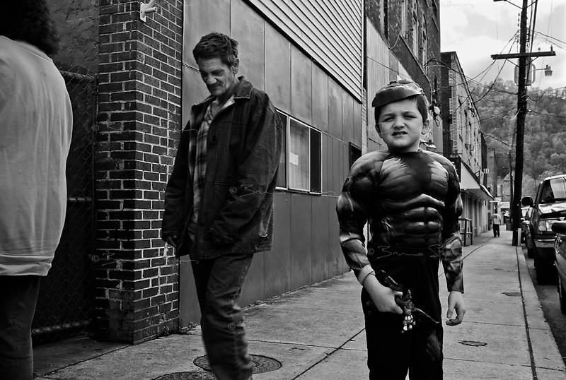 "War, WV, October 25 2008.Tyler, 8, dressed as the Incredible Hulk, on the way to a Halloween party..""West Virginia Southernmost city"", War is a small coal miners' town, hit hard by the economic crisis; many of its inhabitants will vote for Obama as McCain is perceived to be the man from the oil companies, trying to destroy the coal mining industry."