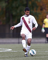 Virginia Tech midfielder Andre Thomas (5) passes the ball. Boston College (maroon) defeated Virginia Tech (Virginia Polytechnic Institute and State University) (white), 3-1, at Newton Campus Field, on November 3, 2013.