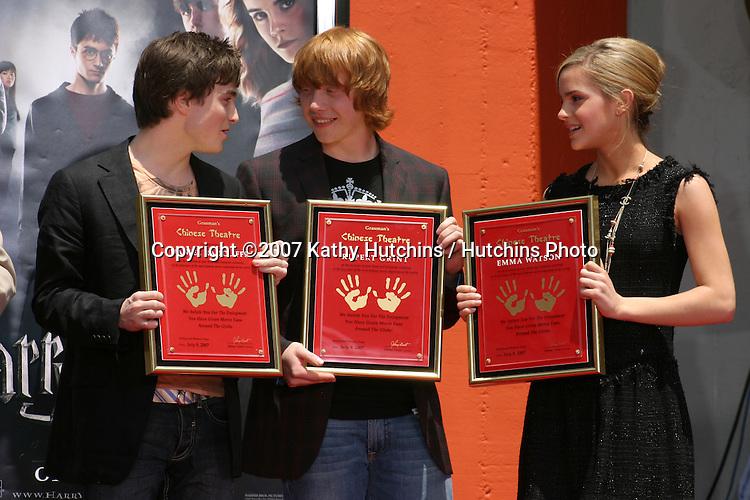 Rupert Grint, Daniel Radcliffe, and Emma Watson.Harry Potter Handprint/Footprint/Wandprint Ceremony.Grauman's Chinese Theater.Los Angeles, CA.July 9, 2007.©2007 Kathy Hutchins / Hutchins Photo...