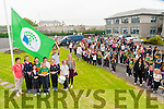Green Flag :Kerry footballer Donnacha Walsh raises the Green flag at Presentation Primary School, Listowel for their achievement in a biodivercity programme.