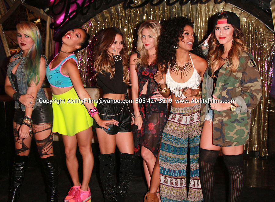 September 24th 2013 <br /> <br /> <br /> Vanessa Hudgens wearing long knee high black boots showing off stomach in short silk shorts posing with girls at the club Bootsy Bellows in Hollywood California.  Vanessa was dancing and singing on stage laughing smiling shoots bubbles from a plastic green space gun. <br /> <br /> <br /> AbilityFilms@yahoo.com<br /> 805 427 3519 <br /> www.AbilityFilms.com