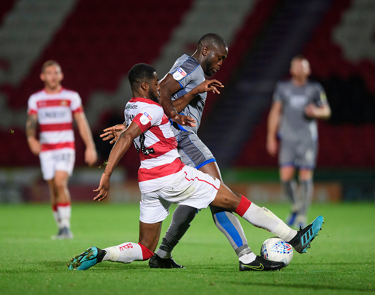 Lincoln City's John Akinde vies for possession with Doncaster Rovers' Cameron John<br /> <br /> Photographer Chris Vaughan/CameraSport<br /> <br /> EFL Leasing.com Trophy - Northern Section - Group H - Doncaster Rovers v Lincoln City - Tuesday 3rd September 2019 - Keepmoat Stadium - Doncaster<br />  <br /> World Copyright © 2018 CameraSport. All rights reserved. 43 Linden Ave. Countesthorpe. Leicester. England. LE8 5PG - Tel: +44 (0) 116 277 4147 - admin@camerasport.com - www.camerasport.com