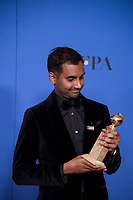 After winning the category of BEST PERFORMANCE BY AN ACTOR IN A TELEVISION SERIES &ndash; COMEDY OR MUSICAL for his role in &quot;Master of None,&quot; actor Aziz Ansari poses backstage in the press room with his Golden Globe Award at the 75th Annual Golden Globe Awards at the Beverly Hilton in Beverly Hills, CA on Sunday, January 7, 2018.<br /> *Editorial Use Only*<br /> CAP/PLF/HFPA<br /> &copy;HFPA/PLF/Capital Pictures