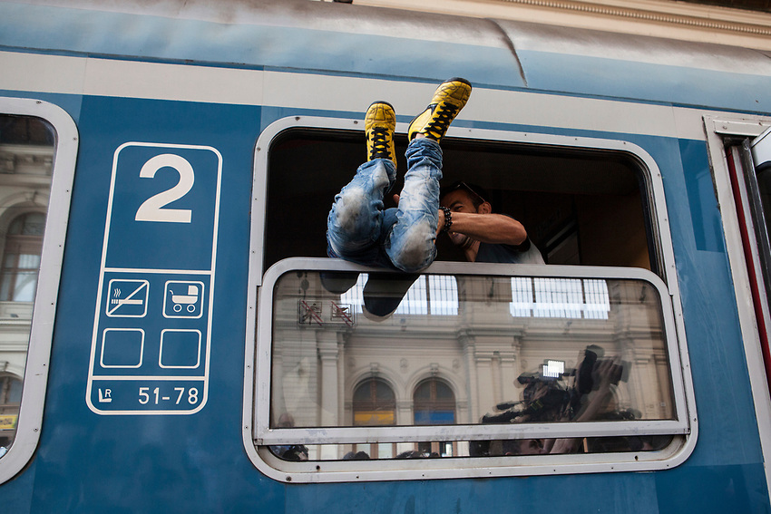 People tried to get on a domestic Hungarian train but were later forced to get off the train by Hungarian police. Mostly Syrian refugees seek rest while waiting for trains to take them away to destinations around Europe. The Hungarian government closed the station and then reopened but cancelled all international trains. Budapest Keleti railway station  is the main international and inter-city railway terminal in Budapest, Hungary.