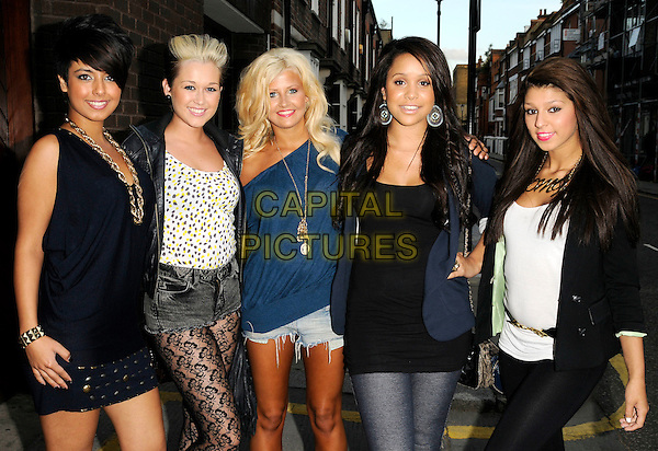 BUBBLE G - BOUJI, BLISS, ELLE, BELLA & COCO.Attending the 'Fabulous' Haircare Range Launch Party, Frankie's Italian Bar & Grill, Yeomans Row, London, England, .25th August 2009..half length girl group black lace tights top blue blazer jacket dress mini skirt top bag print shorts hand on hip.CAP/CAN.©Can Nguyen/Capital Pictures.