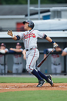 Carlos Castro (19) of the Danville Braves follows through on his swing against the Burlington Royals at Burlington Athletic Park on July 12, 2015 in Burlington, North Carolina.  The Royals defeated the Braves 9-3. (Brian Westerholt/Four Seam Images)