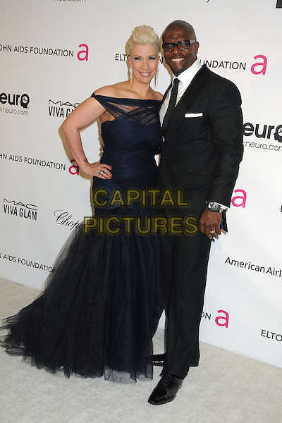 Rebecca Crews, Terry Crews.21st Annual Elton John Academy Awards Viewing Party held at West Hollywood Park, West Hollywood, California, USA..February 24th, 2013.oscars full length black suit off the shoulder tulle dress married husband wife .CAP/ADM/BP.©Byron Purvis/AdMedia/Capital Pictures.