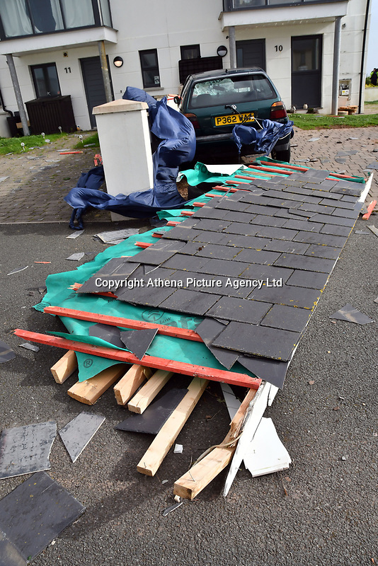 """Pictured: Part of a roof has blown off a block of flats in Penny Point, Pembroke Dock, west Wales. Monday 16 October 2017<br /> Re: Remnants of Hurricane Ophelia are expected to bring strong gusts of wind to Wales when it hits Britain's shores.<br /> The hurricane, making its way from the Azores in the Atlantic Ocean, will have weakened to a storm when it arrives.<br /> A Met Office amber """"be prepared"""" warning has been issued in some areas bringing """"potential danger to life""""."""