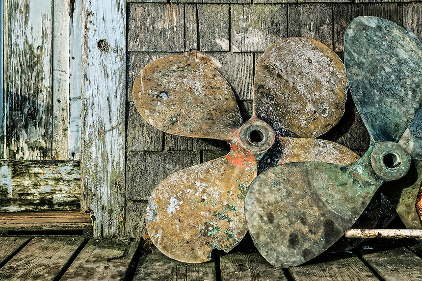Old boat propellers on a fishing village dock, Menemsha, Martha's Vineyard, USA