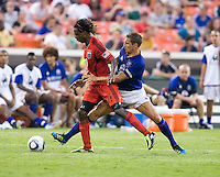 Joseph Ngwenya (11) of D.C. United fights for the ball with Phil Jagielka (6) of Everton during their friendly match held at RFK Stadium in Washington, DC.  D.C. United lost to Everton, 3-1.