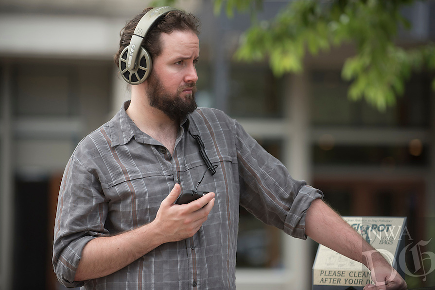 "NWA Democrat-Gazette/J.T. WAMPLER Jack Nicholson of Fayetteville listens Sunday May 29, 2016 to ""Secret Life of Downtown Fayetteville"", an audio walking tour that re-imagines the history and legacy of Fayetteville's downtown square in an audio-guided tour created by Artist's Laboratory Theatre."