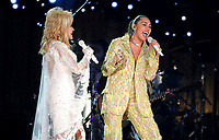 "Dolly Parton, left, and Miley Cyrus perform ""Jolene"" at the 61st annual Grammy Awards on Sunday, Feb. 10, 2019, in Los Angeles. (Photo by Matt Sayles/Invision/AP)"