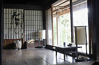 In the main living area sliding glass doors blur the distinction between outside and inside