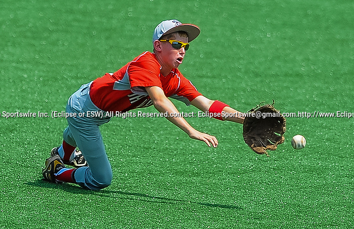 Mattoon(IL)'s Nicholas Owens tries to make a catch during the Cal Ripken Babe Ruth World Series in Aberdeen, Maryland on August 12, 2012