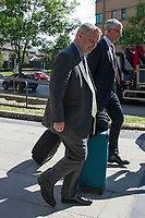 Pictured: Chris Davies, MP (L) leaves Cardiff Magistrates Court.<br /> Re: A judge has ruled that Conservative MP Chris Davies did not deliberately mislead an employment tribunal when he said that he would not face criminal charges over expenses claims.<br /> But the Brecon and Radnorshire MP later pleaded guilty to claiming £700 with false invoices for office photographs.<br /> He is being sued for constructive dismissal by his former constituency office manager, Sarah Lewis.<br /> The judge in Cardiff said the case will go to a full hearing at a later date.
