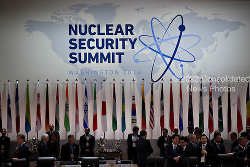 "The Nuclear Security Summit logo stands above flags before an opening plenary entitled ""National Actions to Enhance Nuclear Security"" at the Nuclear Security Summit in Washington, D.C., U.S., on Friday, April 1, 2016. After a spate of terrorist attacks from Europe to Africa, U.S. President Barack Obama is rallying international support during the summit for an effort to keep Islamic State and similar groups from obtaining nuclear material and other weapons of mass destruction. <br /> Credit: Andrew Harrer / Pool via CNP"