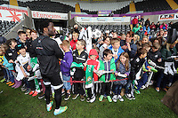 Wednesday, 23 April 2014<br /> Pictured: Wilfried Bony signing autographs for supporters.<br /> Re: Swansea City FC are holding an open training session for their supporters at the Liberty Stadium, south Wales,