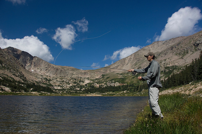 Man fishing during a summer morning at Lawn Lake in Rocky Mountain National Park, Colorado, USA